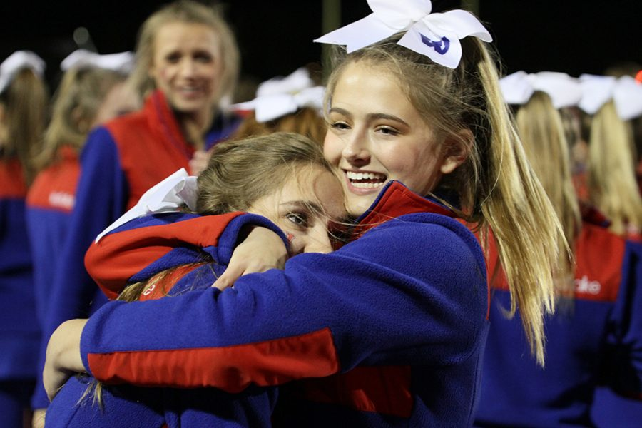 Freshman Kennedy Griebel hugs another cheerleader after Westlake beats Judson in a playoff game on Nov. 19.
