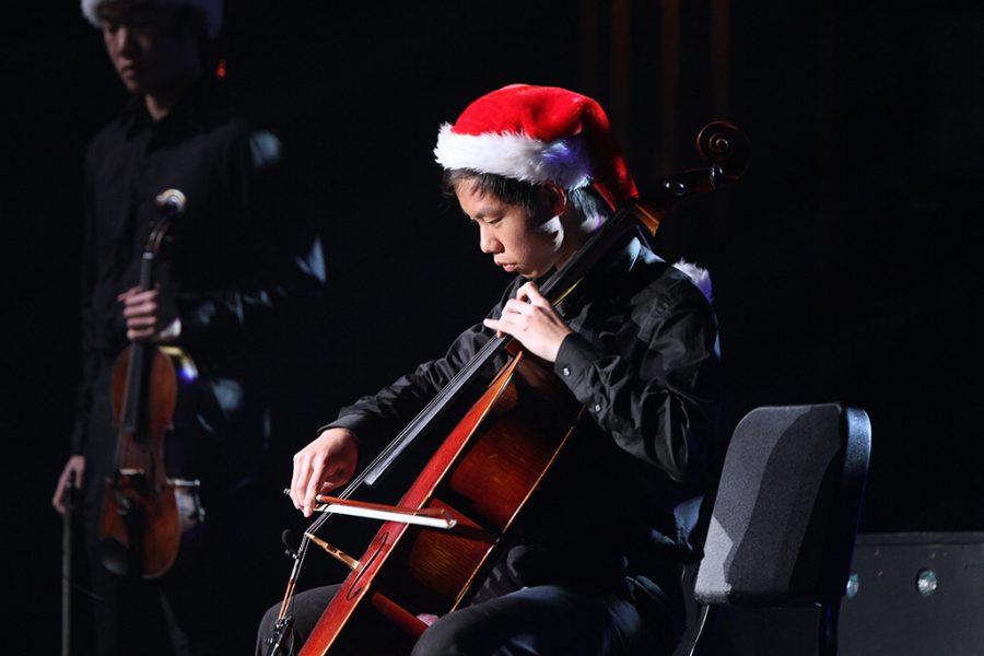 Senior Ryan Zhou plays the cello during the Winter performance of Nutcracker on Dec. 10.