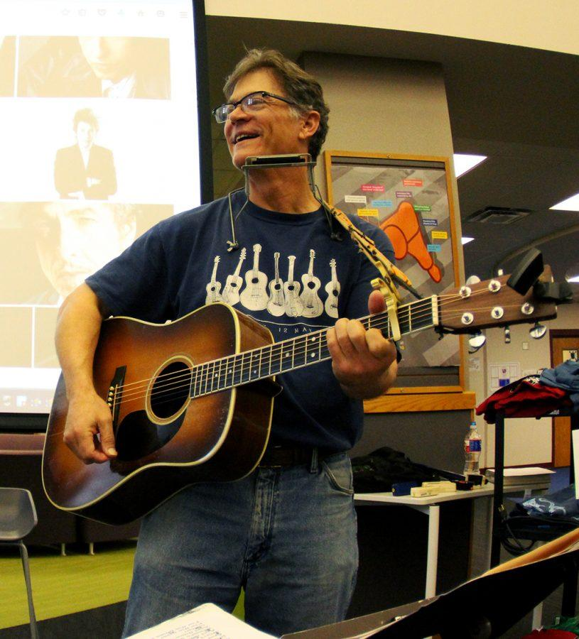 English teacher and girls golf coach Chuck Nowland rejoices the crowd at Dylan Day with some up beat tunes on his guitar.  by jake breedlove