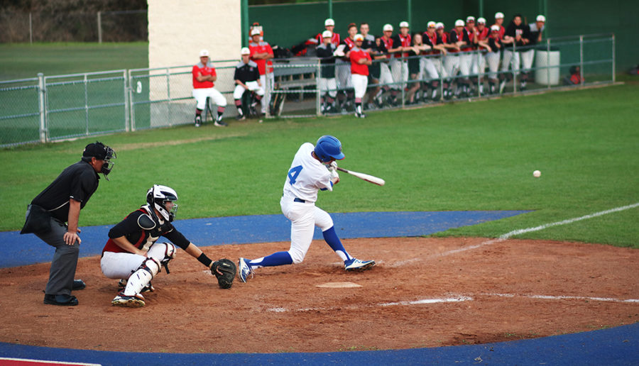 Junior+Luke+Dunlap+bats+at+the+District+game+against+Lake+Travis+March+24.