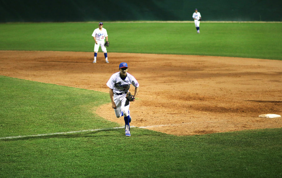 Senior Joe Palmo runs back to his position during a game against Lake Travis March 24.