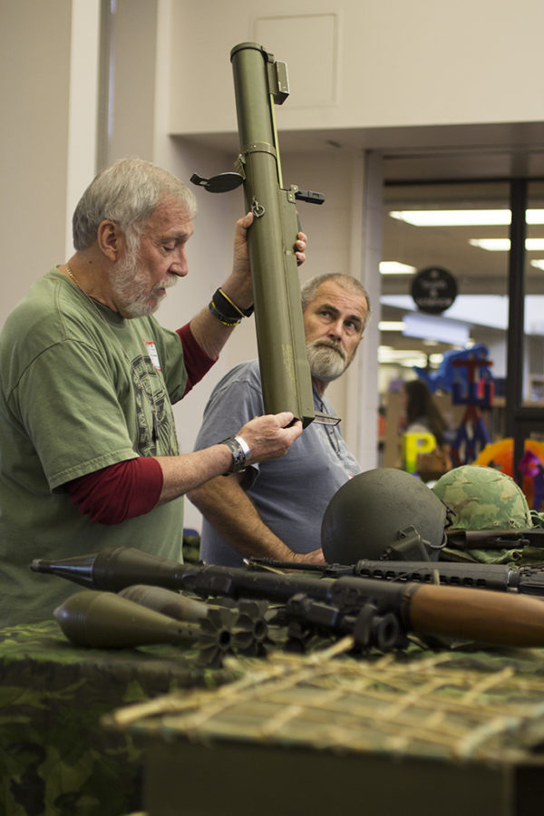 As Ron Dorsey (not seen) explains the troubles that were an outcome of Vietnamese enemies coming into possession of non-detonated American war materials. Meanwhile, his fellow veterans, Don Dorsey and James Hart show the mechanics of how the littered equipment backfired on them.