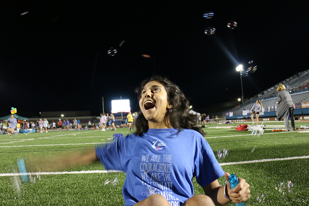 Student volunteer junior Ivany Patel waves a bubble stick around late into the night during Westlake's Relay For Life.