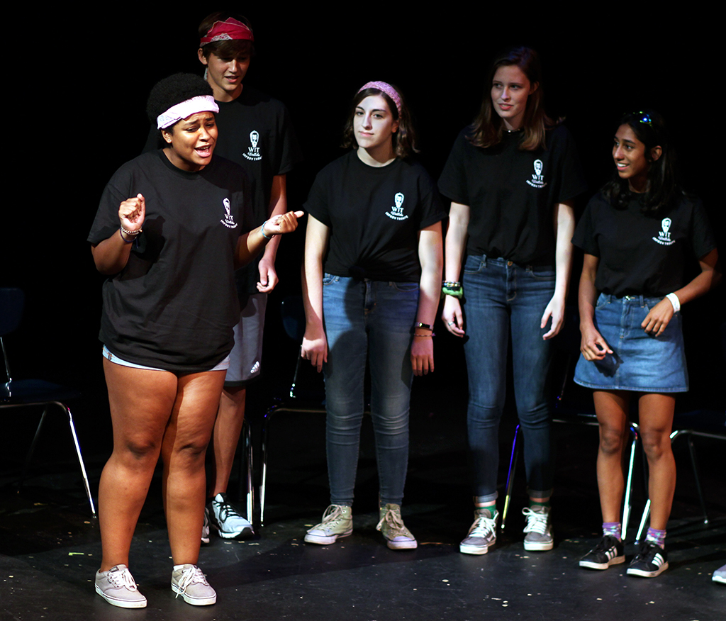 On+Sept+1%2C+in+the+Black+Box+Theatre%2C+the+Westlake+Improv+Troupe+%28more+commonly+known+as+WIT%29+had+their+first+performance+of+the+year.+Sophomore+Jemima+Abalogu+is+starting+the+show+off+strong%2C+and+getting+people+to+laugh+just+by+introducing+herself.+Apart+from+entertaining+the+audience%2C+one+thing+the+group+was+doing+was+collecting+donations+to+help+victims+of+Hurricane+Harvey.