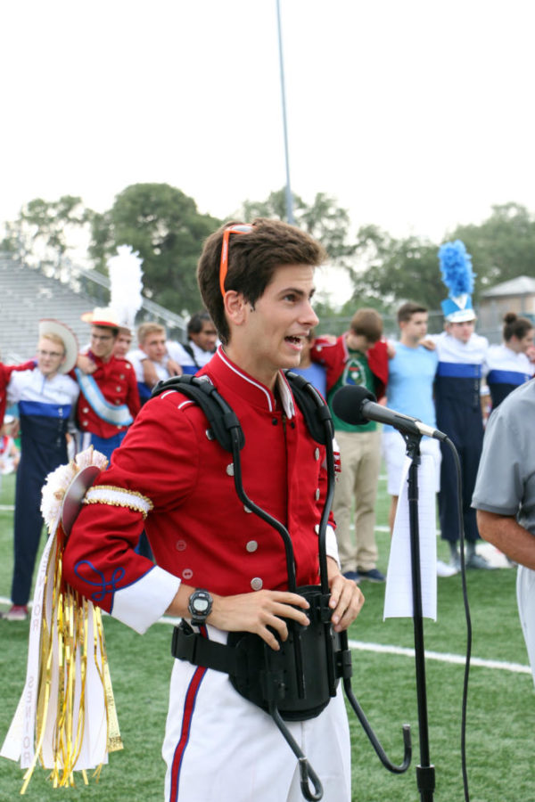 After announcing all the band seniors, senior Matteo Brunel speaks to the crowd about the bands achievements, and urges them to come out and watch their practice run later that night for a competition the next day.