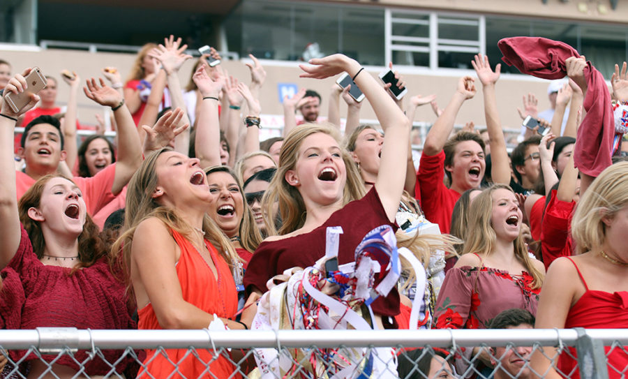 Seniors Olivia Hardage, Abby DAndrea and Fiona Luther cheer for the spirit stick during the Homecoming pep rally on Sept. 22.