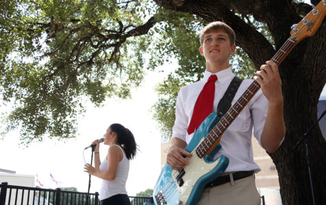 Senior Josh Myers plays bass during the performance by The Fifth Flight during lunch on Sept. 22.