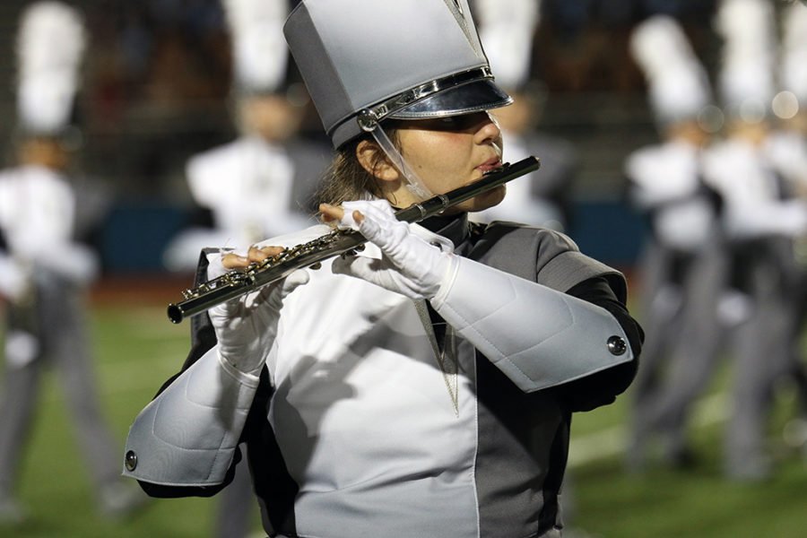 Senior Emma Cranford plays a flute solo during a practice run of a band performance on Sept. 22 after the football game against Bowie.