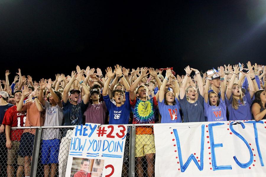 Senior students cheer on their fellow varsity football team, as the Lake Travis game kicks off.- Jake Breedlove