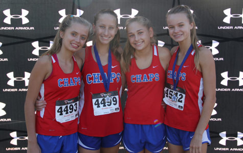 Freshman Cassidy Beard and sophmores Maddie Dawson, Kasey Hedrix and Elise Smoot pose after Maddie and Elise get top 15 in a recent varsity crosscountry race.