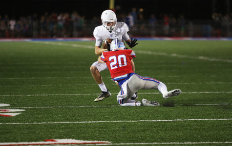 Varsity defensive back senior Collin Swalllow successfully tackles Viper reciever, preventing the Vipers from gaining any more yardage.  -jake breedlove