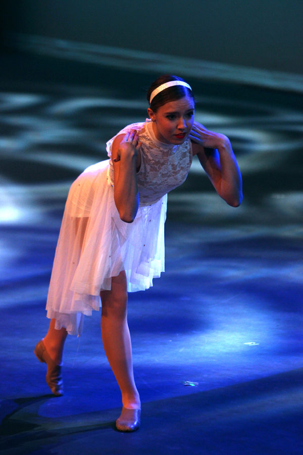 Freshman Brooke Fox solemnly looks away while performing in a group dance in the annual Spotlight performance.