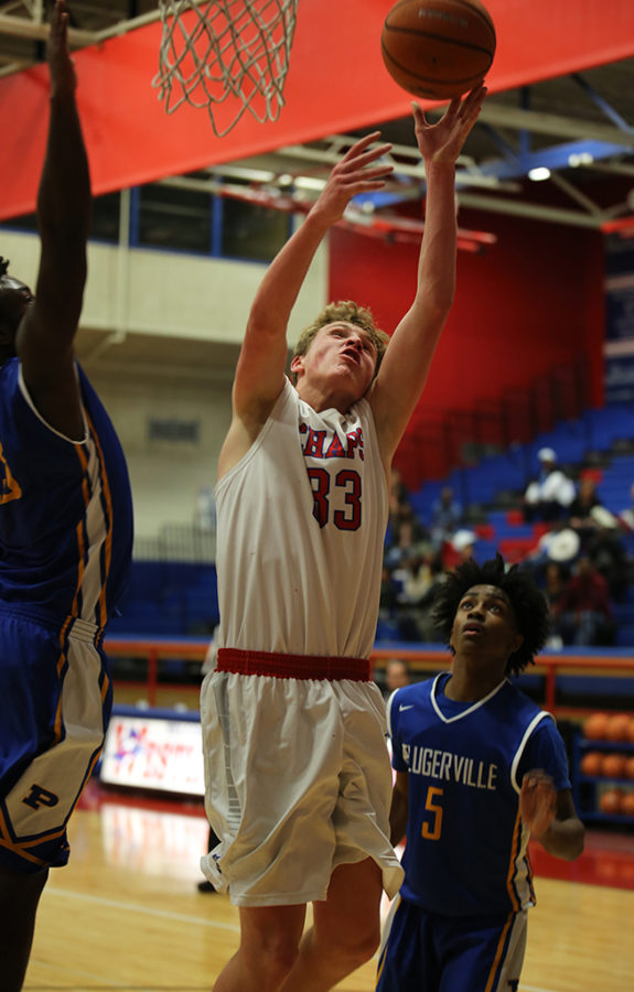 Sophomore Carson May reaches to make a lay-up during the game against Pflugerville on Dec. 5.