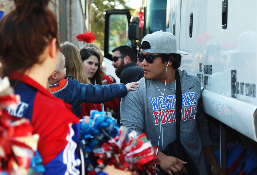 Senior Izaiah Faz says his goodbyes before boarding the bus to Houston for the playoff game against Cy-Fair.
