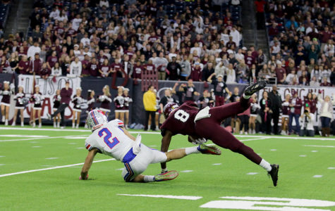 Senior wide receiver Jake Ramos attempts to receive pass thrown by junior quarterback Taylor Anderson, but sadly Cy Fair defender intercepts the ball.  by Jake Breedlove