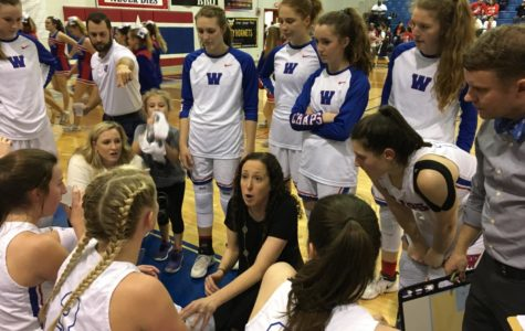 Westlake head coach Katie Hensle addresses her team in the first half of their Regional Quarterfinal game against Judson. They went on to lose the game, 41-54.