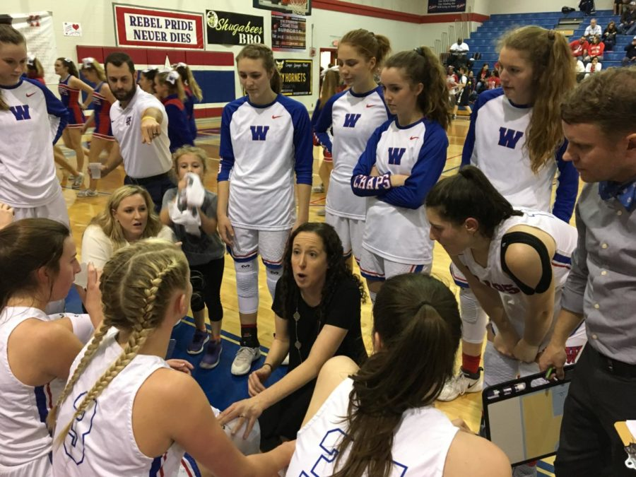 Westlake+head+coach+Katie+Hensle+addresses+her+team+in+the+first+half+of+their+Regional+Quarterfinal+game+against+Judson.+They+went+on+to+lose+the+game%2C+41-54.+