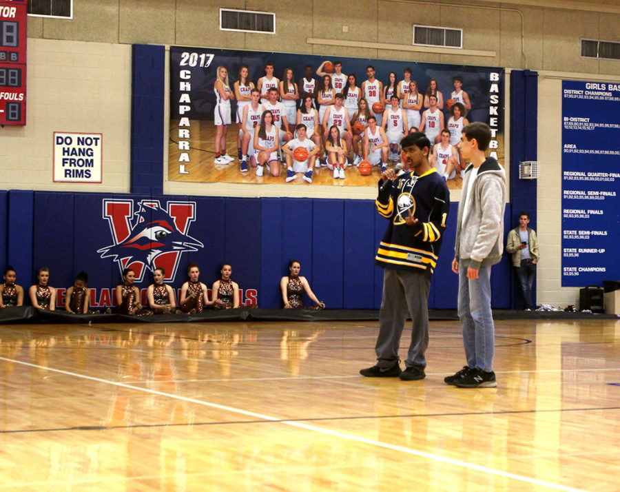 Seniors Aro Majumder and Conor O'Bryon represent the Westlake Featherduster at last Thursday's pep rally. They advertised our newest issue,