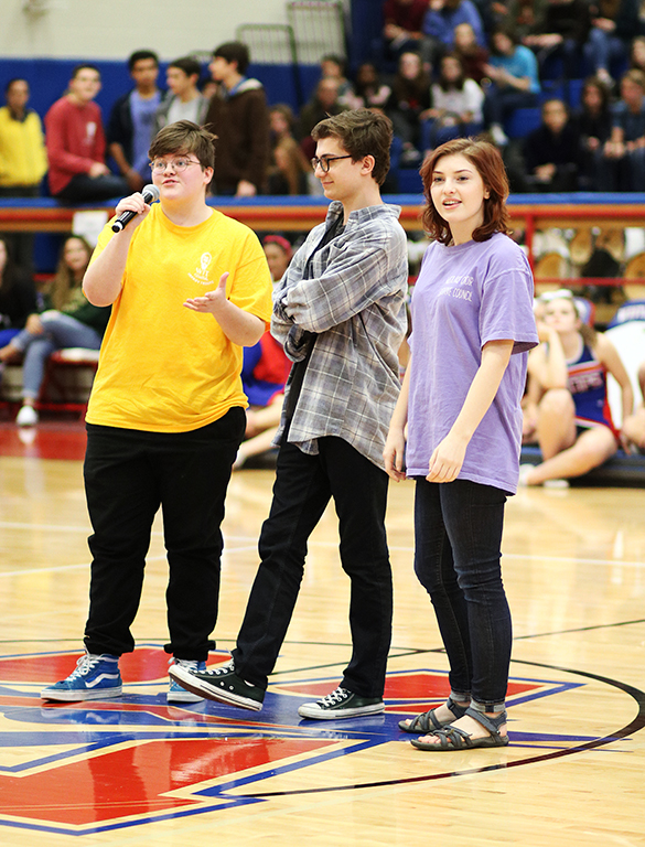 Seniors Harley Harris, Ty Bock and Caroline Ellenthal represent the theater program and talk about its recent accomplishments at the spring pep rally Feb. 22.