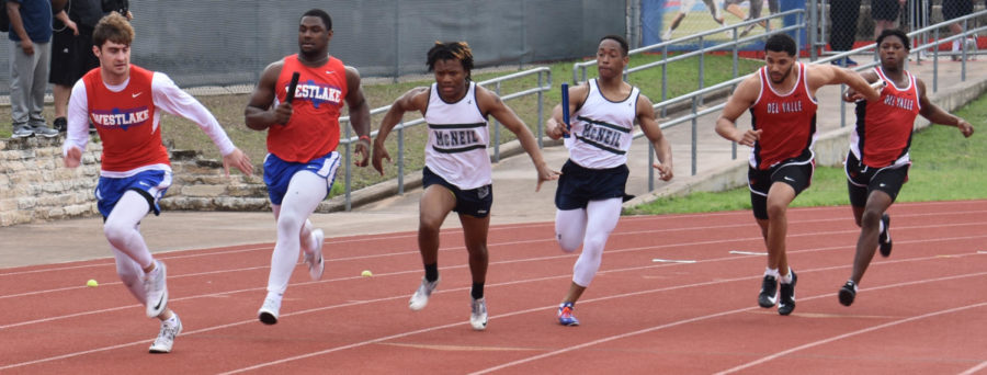 Seniors Jake Ramos and Nikia Watson run the 4 x 100 m relay Feb. 24 at the Chap Relays.