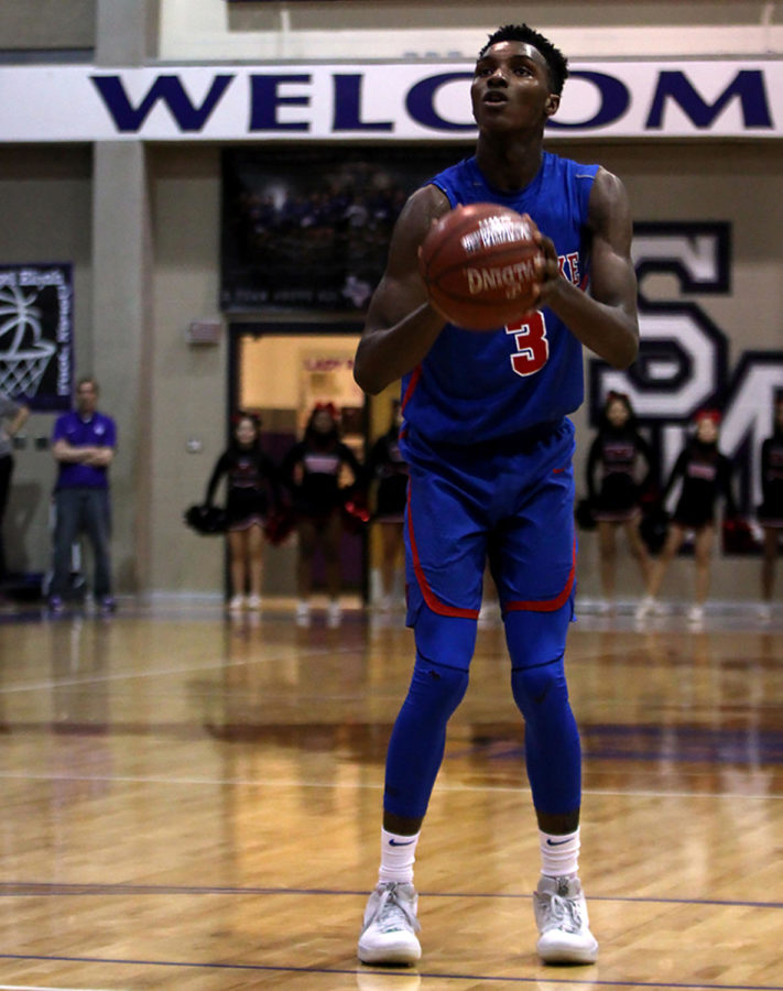 Senior Guard Keonte Kennedy shoots a free throw at the Regional Quarterfinal Playoff between Westlake and Wagner. Westlake went away victorious with a score of 58-57.