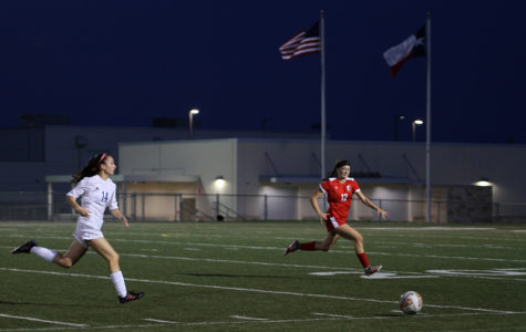 Junior Ally Huang chases after the ball in front of a defender in Westlake's April 6 playoff game vs Lake Travis.