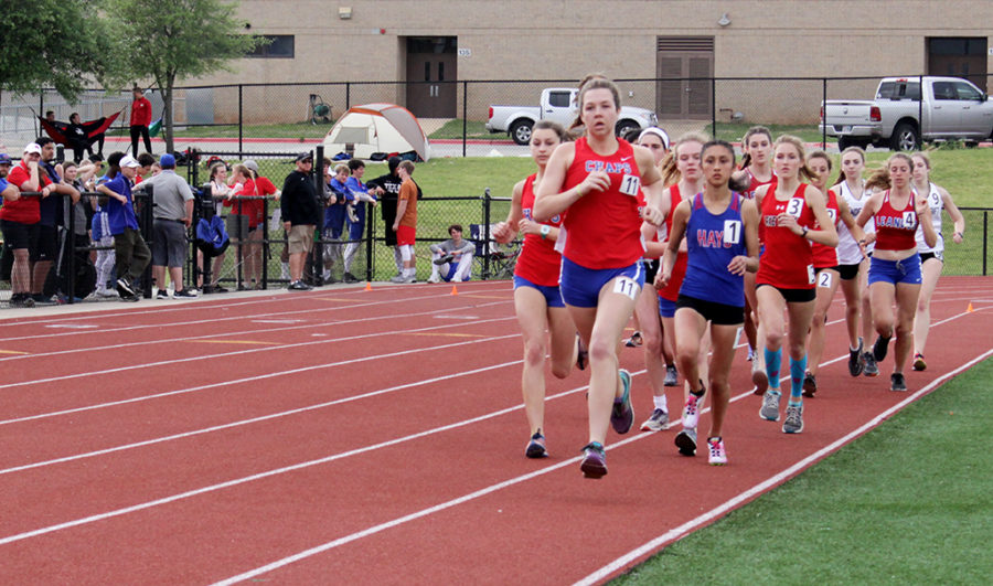 Sophomore Abby George runs in the JV 800 at the District meet on April 5, finishing first in the race.