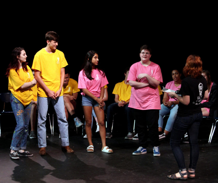 Senior Emma Parsons, Sophomores Andrew Mountain and Nikita Kakkad, and Senior Harley Harris explain a movie pitch to WIT captain Senior Caroline Ellenthal. This WIT show was held friday at 7pm in the Black Box theatre.