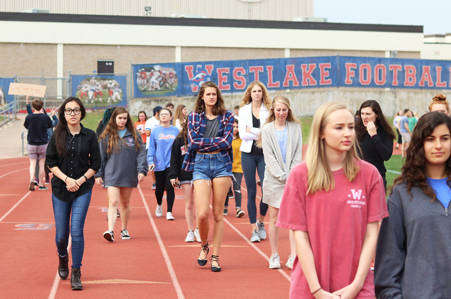 Students walk into the stadium to take part in the walkout to remember shooting victims and to protest gun violence April 20.