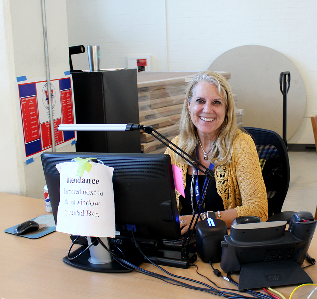 Receptionist Karen Lear at her station in the Chap Court. Lear is in charge of regulating the buzz-in system, one of the new security improvements.