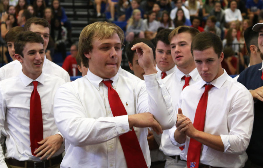 Football player senior Blake Webster does the traditional hat dance at the end of the pep rally Oct. 12.