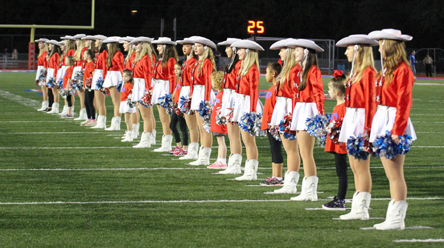 Hyline includes elementary girls in welcoming Westlake football players in the Hays game on October 26.