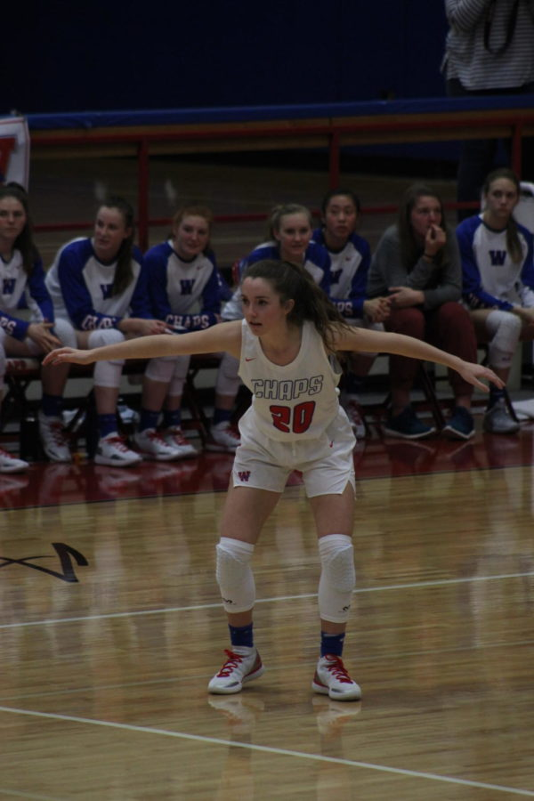 Junior Emily Marquis keeps her eye on the ball during the girls varsity basketball game on Dec. 21.
