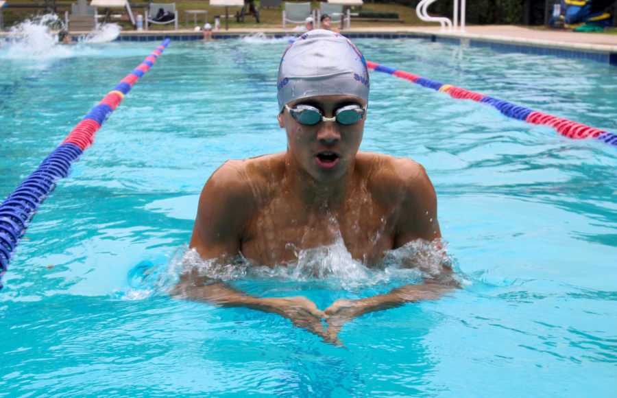 Junior Brian Li works on his breaststroke as he prepares for his races at State.