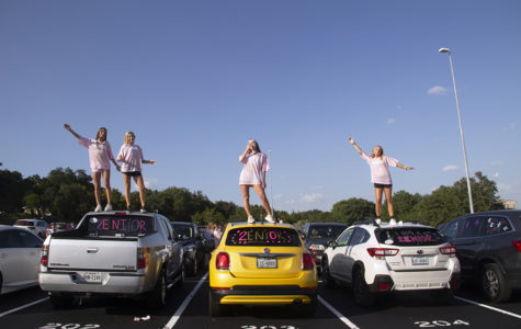 Seniors Maddie Dawson, Tori Fredell, Daniela Miro and Kasey Hendrix pose on their decorated cars in the PAC parking lot Aug. 20.