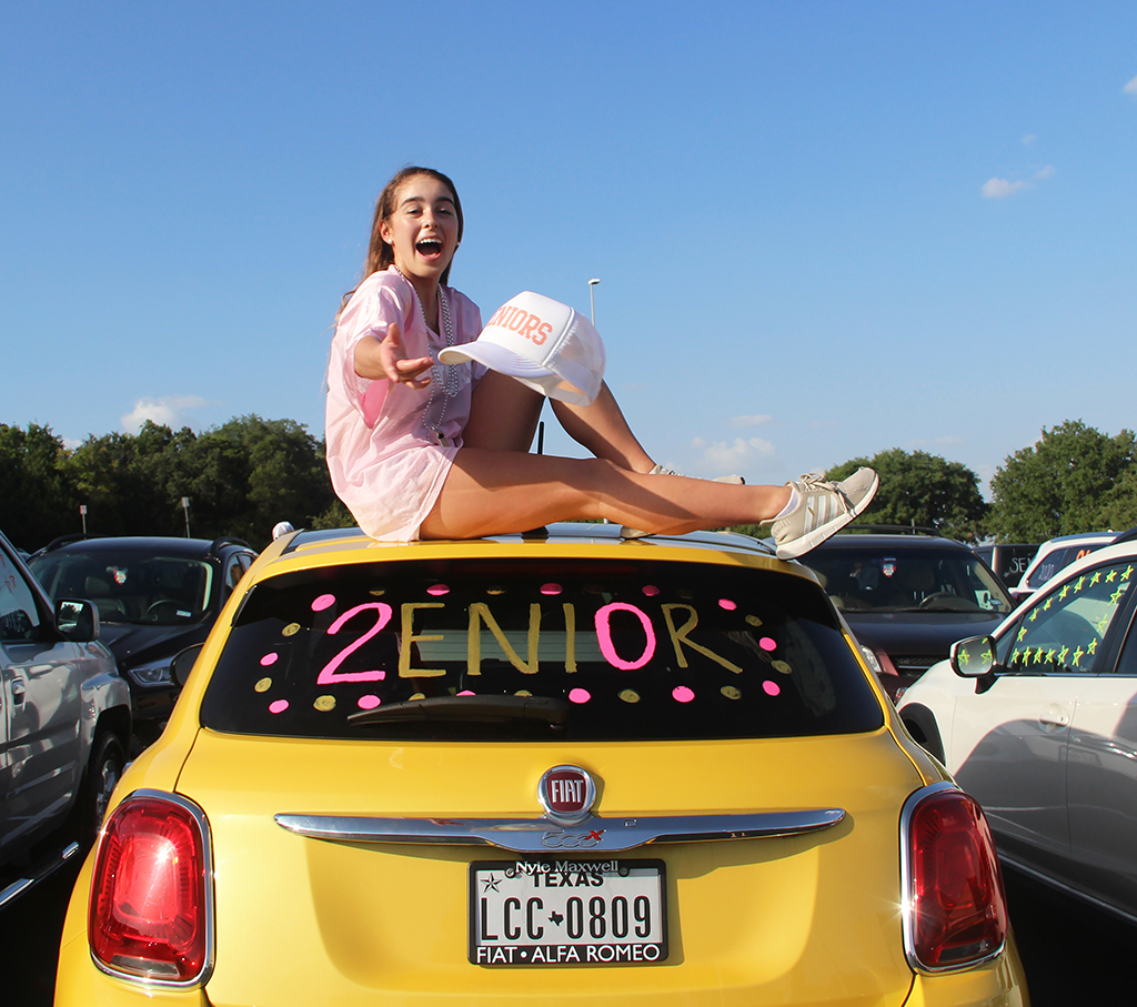 Daniela+Miro+throws+her+cap+off+on+top+of+her+decorated+car+in+the+PAC+parking+lot+Aug.+20.