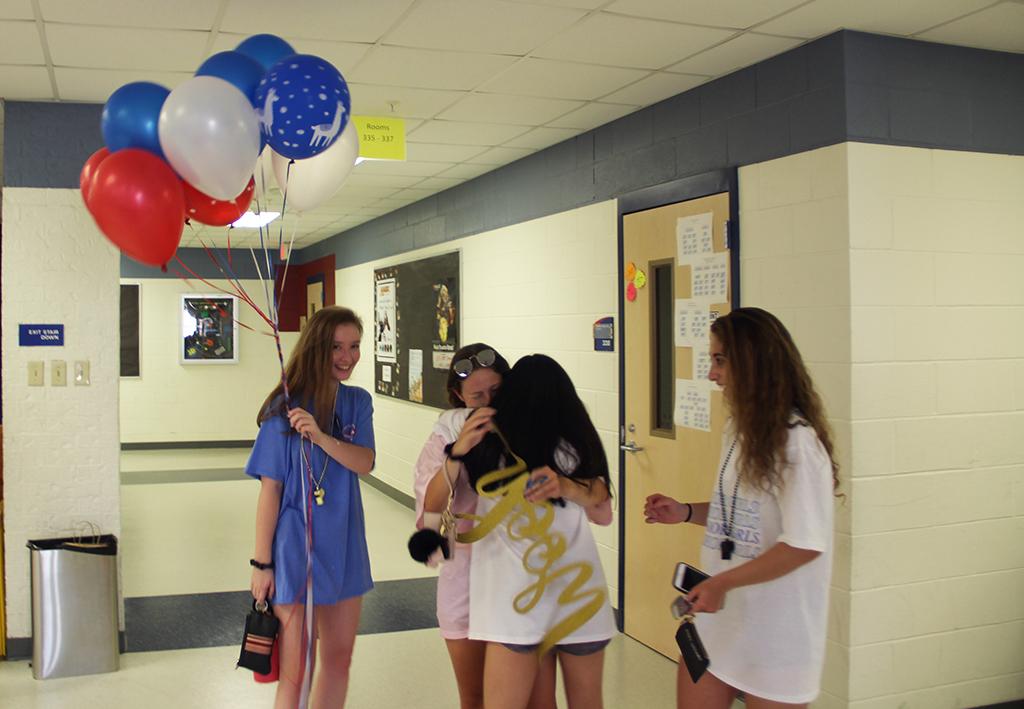 Senior+Anna+Pagley+hugs+senior+Kimmie+Auth+Aug.+20+at+the+Senior+Girls+back-to-school+celebration.