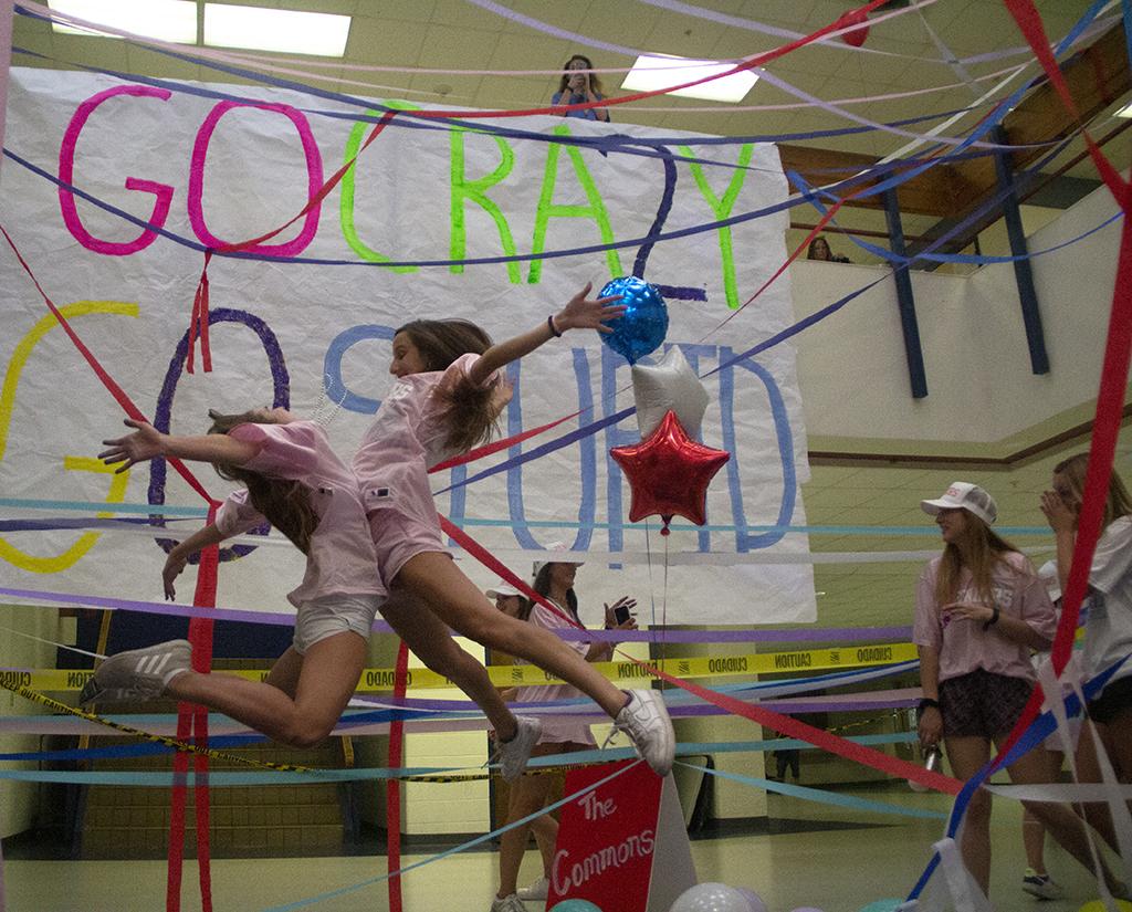 Seniors+Maddie+Dawson+and+Daniela+Miro+jump+for+joy+at+the+Senior+Girls+celebration+Aug.+20.+