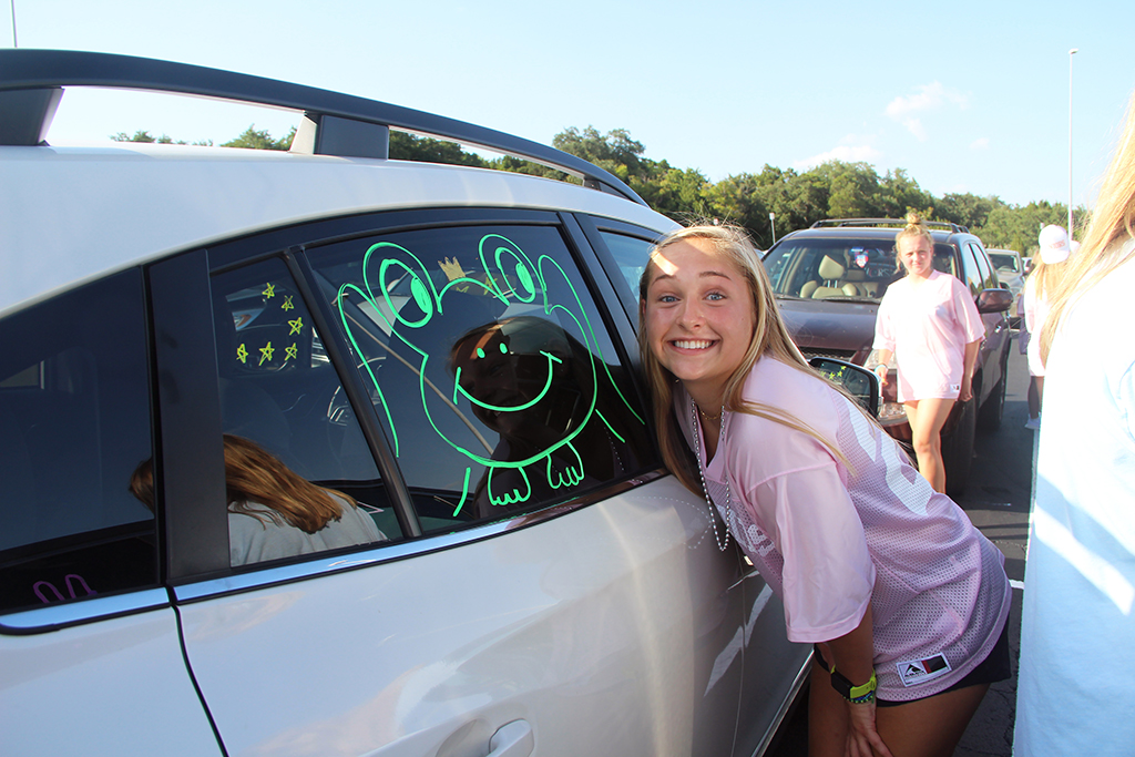 Senior+Kasey+Hendrix+poses+next+to+her+decorated+car+Aug.+20+in+the+PAC+parking+lot.+