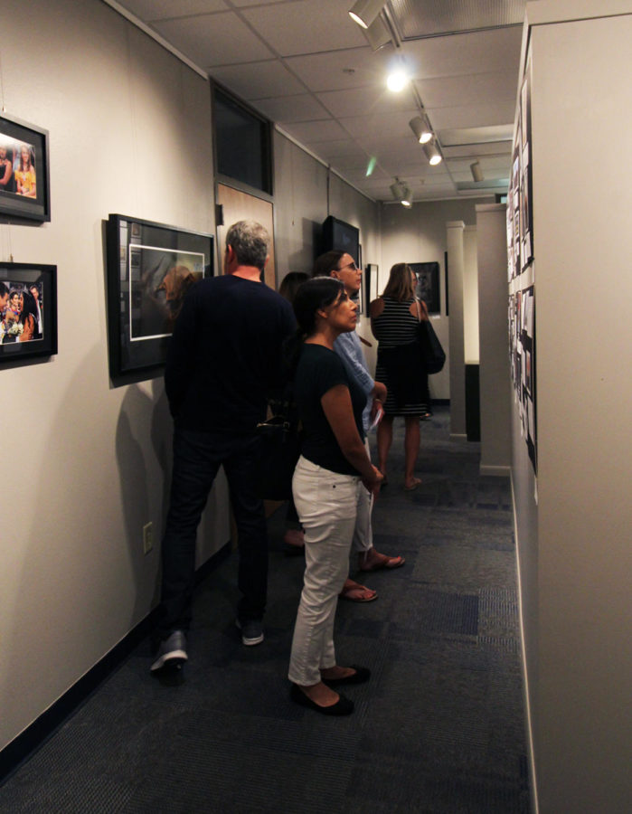 Parents view artwork created by students in the Uncommon Space Art Gallery during Back to School night on Sept. 4. The Art Department opened up the gallery for all the parents to waunder around and view the student-made artwork.