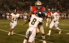 Defensive scoring outbreak helps varsity football over Akins