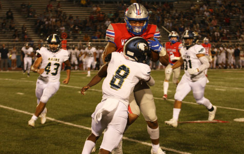 Freshman Jaden Greathouse gets tackled by an Akins Highschool player during the football game on Sept. 13. Westlake won the game 58-7.