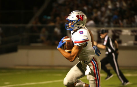 Freshman Jaden Greathouse runs with the ball during the Westlake football game vs. Austin High School at House Park on Sept. 20. Westlake beat Austin High 63-8.