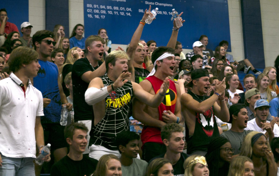 Seniors Bailey Covert, Elliot Schwarzbach and Peyton Prince cheer on friend duing Austin High pep rally on Sept. 20