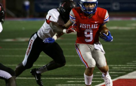 During Westlake high School's Homecoming game, freshman Jaden Greathouse is about to be tackled by a Del Valle Cardinal into the endzone. Greathouse is the only freshman on the varsity team.