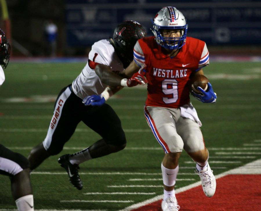 During+Westlake+high+School%27s+Homecoming+game%2C+freshman+Jaden+Greathouse+is+about+to+be+tackled+by+a+Del+Valle+Cardinal+into+the+endzone.+Greathouse+is+the+only+freshman+on+the+varsity+team.