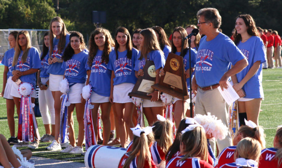 Coach+Nowland+announces+the+seniors+on+the+girls+gold+team+at+the+Homecoming+pep+rally+on+October+18