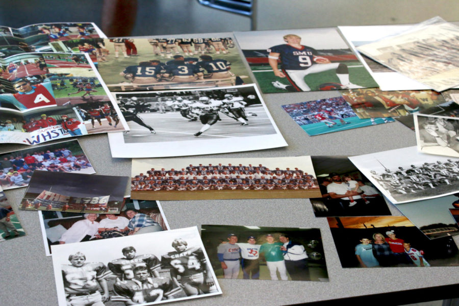 Photos of football from the past are spread on tables in the Chap Court at the Westlake Alumni Association Ceremony Oct. 19.