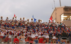 Middle school students participate in high school band