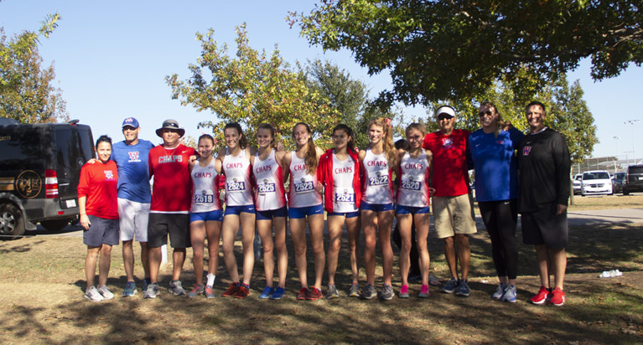 The girls varsity cross country team, coaches and principal Steve Ramsey pose after the Chaps placed 11th at State Nov. 9.